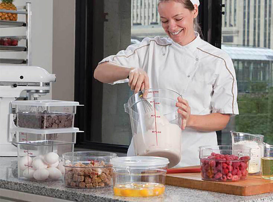 baker using Cambro containers to bake in her kitchen