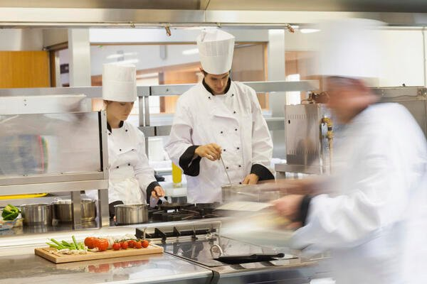 Chefs in busy kitchen