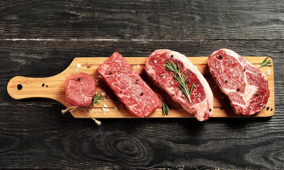 Steaks on a cutting board.