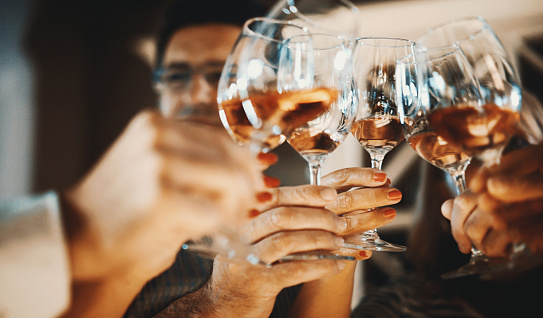 Wine tasting - Group of friends clinking glasses